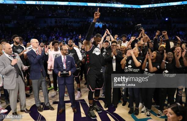 LeBron James of the LA Lakers and Team LeBron celebrates with representatives of the Right Moves for Youth Charlotte charity after their 178-164 win...