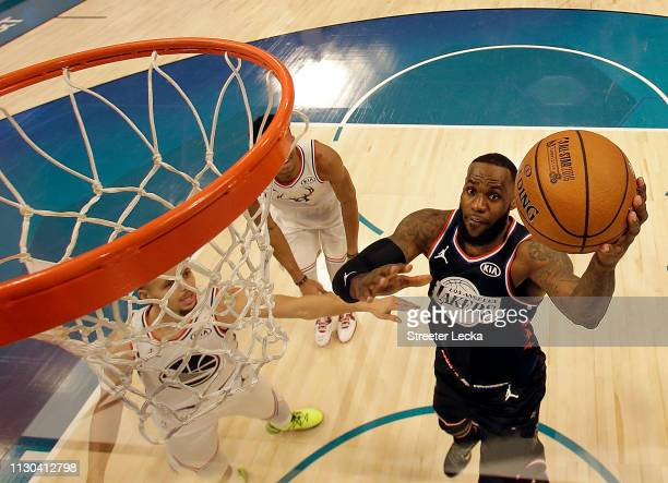LeBron James of the LA Lakers and Team LeBron shoots against Stephen Curry of the Golden State Warriors and Team Giannis in the second half during...