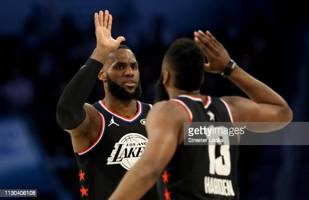 LeBron James of the LA Lakers and teammate James Harden of the Houston Rockets and Team LeBron react against Team Giannis during the NBA AllStar game...