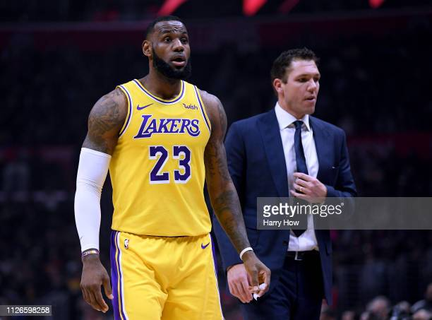 LeBron James of the Los Angeles Lake reacts to the bench in front of Luke Walton during the first half against the Los Angeles Clippers at Staples...