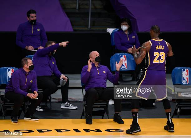 LeBron James of the Los Angeles Lakers acts out a play in front of the coach Jason Kidd during a 102-93 win over the Portland Trail Blazers at...