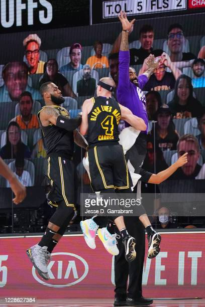 LeBron James of the Los Angeles Lakers Alex Caruso of the Los Angeles Lakers and JR Smith celebrate during a game against the Denver Nuggets during...