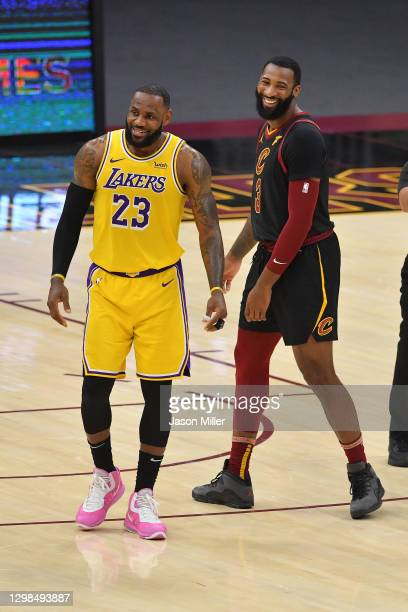 LeBron James of the Los Angeles Lakers and Andre Drummond of the Cleveland Cavaliers joke with teammates during the fourth quarter at Rocket Mortgage...