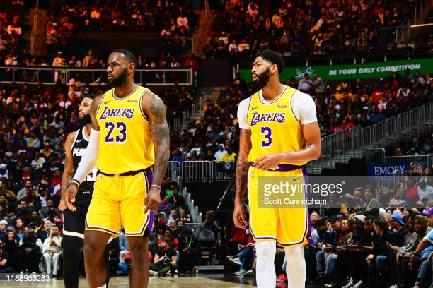 LeBron James of the Los Angeles Lakers and Anthony Davis of the Los Angeles Lakers look on during a game against the Atlanta Hawks on December 15...