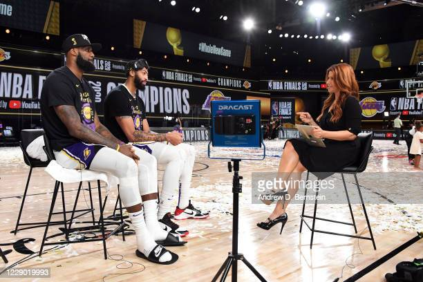 LeBron James of the Los Angeles Lakers and Anthony Davis of the Los Angeles Lakers talk to Sideline Reporter Rachel Nichols after Game Six of the NBA...