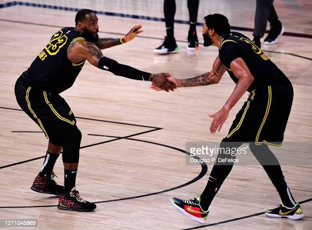 LeBron James of the Los Angeles Lakers and Anthony Davis of the Los Angeles Lakers react during the fourth quarter against the Houston Rockets in...