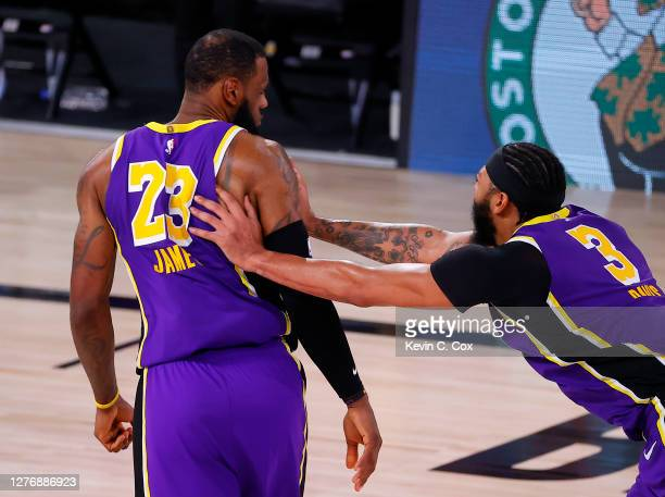 LeBron James of the Los Angeles Lakers and Anthony Davis of the Los Angeles Lakers react during the fourth quarter against the Denver Nuggets in Game...