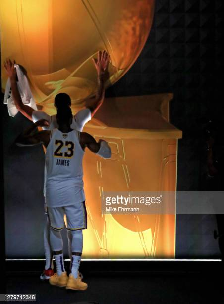 LeBron James of the Los Angeles Lakers and Anthony Davis of the Los Angeles Lakers react after winning the 2020 NBA Championship in Game Six of the...