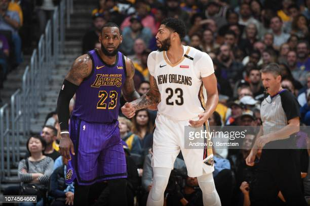 LeBron James of the Los Angeles Lakers and Anthony Davis of the New Orleans Pelicans fight for position during a game on December 21 2018 at STAPLES...