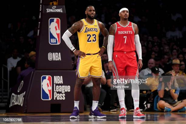 LeBron James of the Los Angeles Lakers and Carmelo Anthony of the Houston Rockets wait for and inbound at Staples Center on October 20, 2018 in Los...