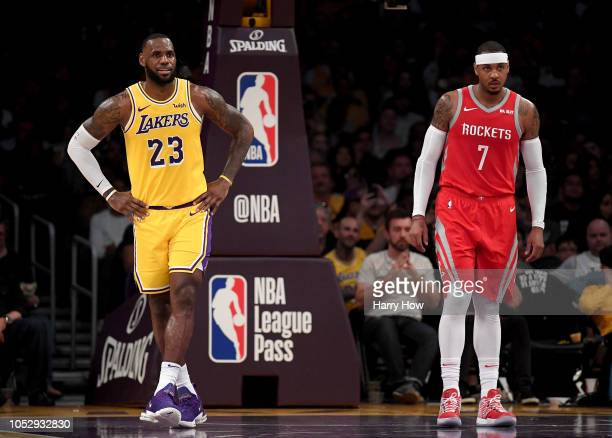 LeBron James of the Los Angeles Lakers and Carmelo Anthony of the Houston Rockets wait for and inbound at Staples Center on October 20 2018 in Los...