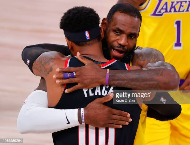 LeBron James of the Los Angeles Lakers and Carmelo Anthony of the Portland Trail Blazers hug before the start of Game Five of the Western Conference...