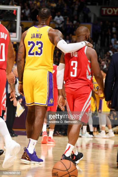LeBron James of the Los Angeles Lakers and Chris Paul of the Houston Rockets look on during the game on October 20 2018 at STAPLES Center in Los...