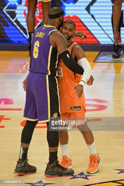 LeBron James of the Los Angeles Lakers and Chris Paul of the Phoenix Suns hug before the game on October 22, 2021 at STAPLES Center in Los Angeles,...