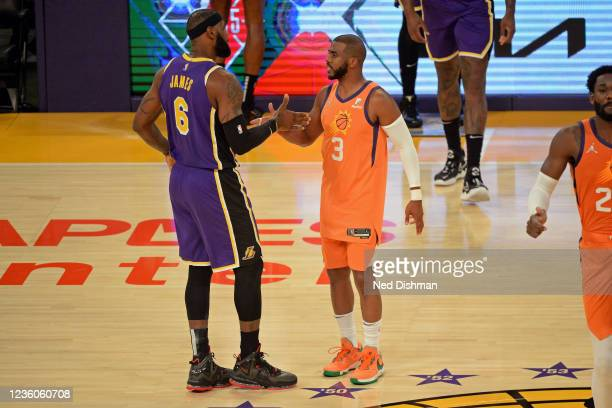 LeBron James of the Los Angeles Lakers and Chris Paul of the Phoenix Suns shake hands before the game on October 22, 2021 at STAPLES Center in Los...