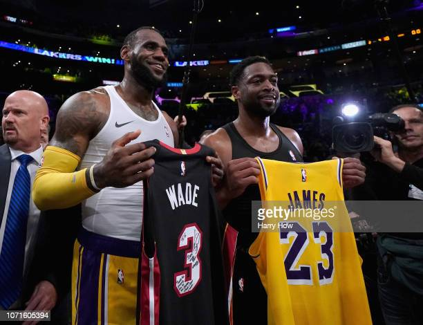 LeBron James of the Los Angeles Lakers and Dwyane Wade of the Miami Heat pose for a photo after exchanging jerseys as Wade plans to retire at the end...