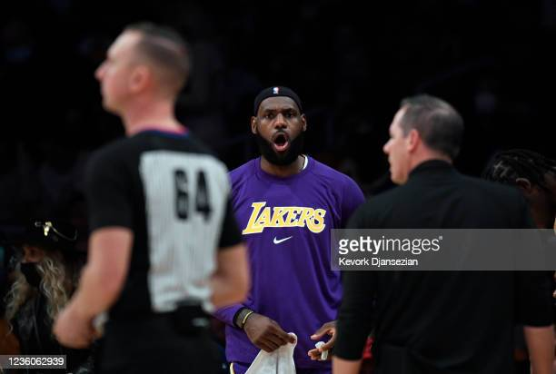 LeBron James of the Los Angeles Lakers and head coach Frank Vogel of the complain to referee Justin Van Duyne during the second half against Phoenix...