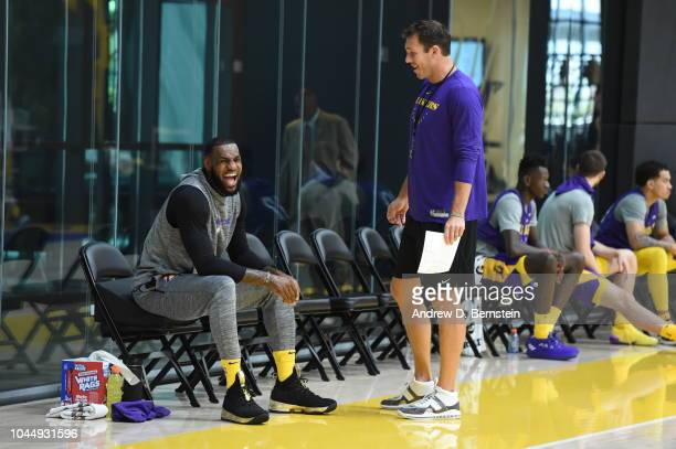 LeBron James of the Los Angeles Lakers and Head Coach Luke Walton look on at practice at UCLA Health Training Center on September 25 2018 in El...
