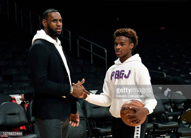 LeBron James of the Los Angeles Lakers and his son LeBron James Jr on the court after the Los Angeles Clippers and Los Angeles Lakers basketball game...