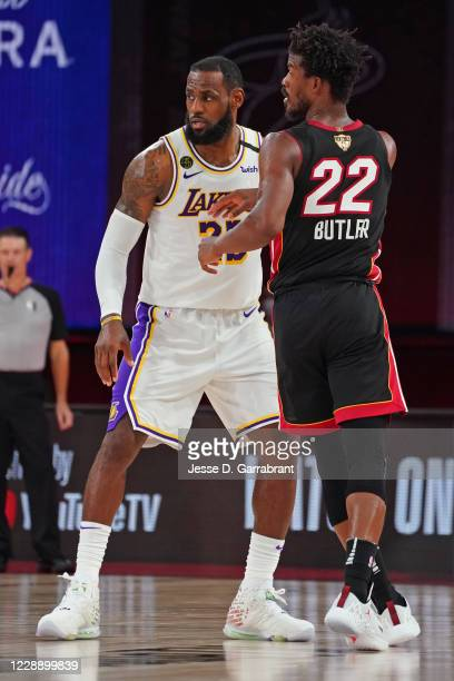LeBron James of the Los Angeles Lakers and Jimmy Butler of the Miami Heat guard each other during Game Three of the NBA Finals on October 4, 2020 in...