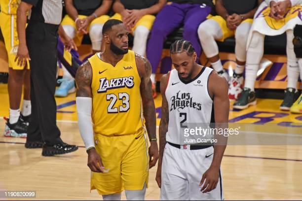 LeBron James of the Los Angeles Lakers and Kawhi Leonard of the LA Clippers look on during the game on December 25 2019 at STAPLES Center in Los...