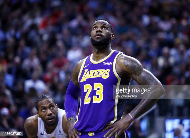 LeBron James of the Los Angeles Lakers and Kawhi Leonard of the Toronto Raptors look on during the second half of an NBA game at Scotiabank Arena on...