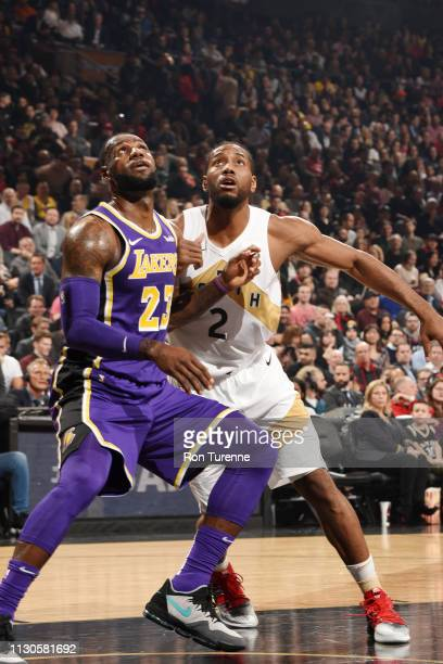 LeBron James of the Los Angeles Lakers and Kawhi Leonard of the Toronto Raptors fight for position at Scotiabank Arena on March 14 2019 in Toronto...
