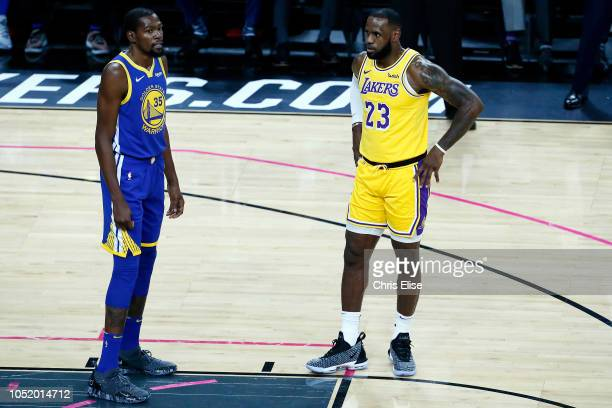 LeBron James of the Los Angeles Lakers and Kevin Durant of the Golden State Warriors look on during the game on October 10 2018 at TMobile Arena in...