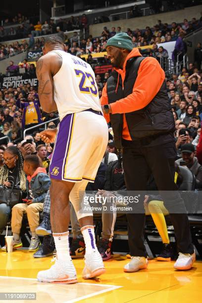 LeBron James of the Los Angeles Lakers and Kobe Bryant talk during the game against the Dallas Mavericks on December 29 2019 at STAPLES Center in Los...