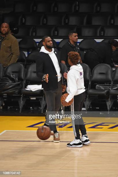 LeBron James of the Los Angeles Lakers and LeBron James Jr highfive after a game between the LA Clippers and the Los Angeles Lakers on December 28...