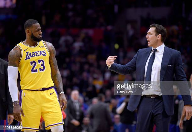 LeBron James of the Los Angeles Lakers and Luke Walton talk during a timeout during a 123120 win over the LA Clippers at Staples Center on January 31...