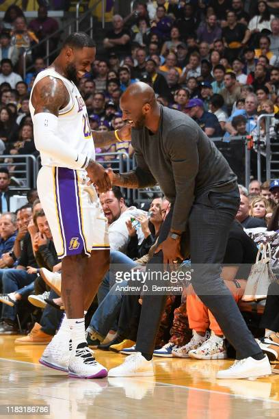 LeBron James of the Los Angeles Lakers and NBA legend Kobe Bryant smile before the game against the Atlanta Hawks on November 17 2019 at STAPLES...