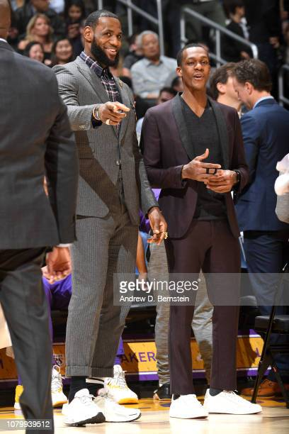 LeBron James of the Los Angeles Lakers and Rajon Rondo of the Los Angeles Lakers look on against the Detroit Pistons on January 9 2019 at STAPLES...
