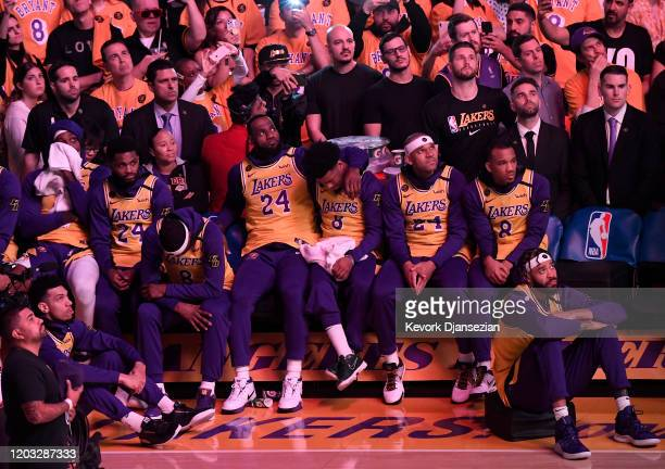 LeBron James of the Los Angeles Lakers and teammates look on during the pregame ceremony to honor Kobe Bryant before the game against the Portland...