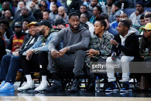 LeBron James of the Los Angeles Lakers and wife Savannah James look on while watching Sierra Canyon High School during the Ohio Scholastic PlayByPlay...