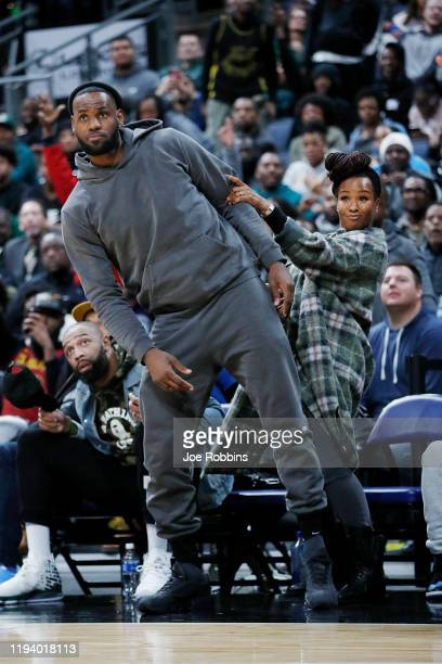 LeBron James of the Los Angeles Lakers and wife Savannah James react while watching Sierra Canyon High School during the Ohio Scholastic PlayByPlay...