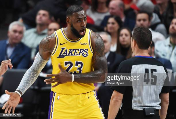 LeBron James of the Los Angeles Lakers argues with referee Brian Forte in the second quarter of their game against the Portland Trail Blazers at Moda...