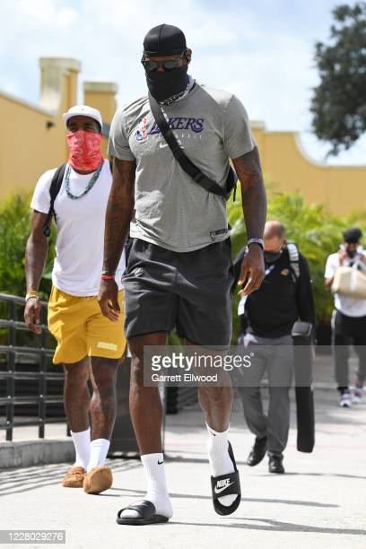 LeBron James of the Los Angeles Lakers arrives to the arena before the game against the Sacramento Kings on August 13 2020 in Orlando Florida at...