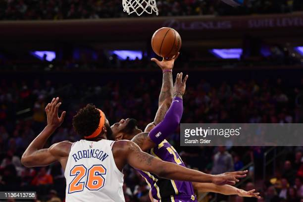 LeBron James of the Los Angeles Lakers attempts a basket against Mitchell Robinson of the New York Knicks during the first half of the game at...