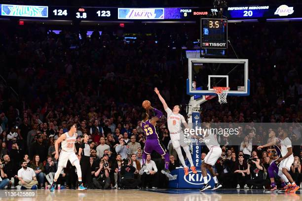 LeBron James of the Los Angeles Lakers attempts a basket but is blocked by Mario Hezonja of the New York Knicks in the last seconds of the game at...