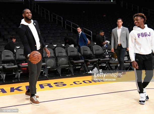 LeBron James of the Los Angeles Lakers attempts a scoop shoot as his son LeBron James Jr looks on after the Los Angeles Clippers and Los Angeles...