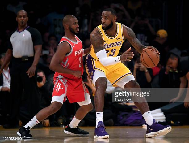 LeBron James of the Los Angeles Lakers backs in on Chris Paul of the Houston Rockets during a 124115 Laker loss at Staples Center on October 20 2018...