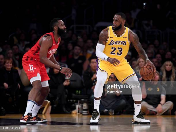 LeBron James of the Los Angeles Lakers backs in on James Harden of the Houston Rockets during a 111106 Laker win at Staples Center on February 21...