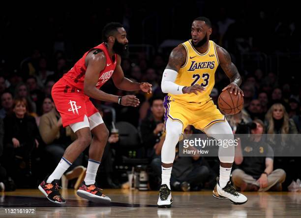 LeBron James of the Los Angeles Lakers backs in on James Harden of the Houston Rockets during a 111-106 Laker win at Staples Center on February 21,...