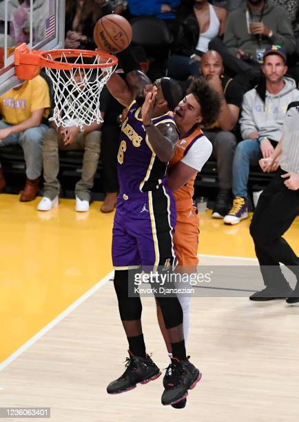 LeBron James of the Los Angeles Lakers blocks a slam dunk by Cameron Johnson of the Phoenix Suns during the second half against at Staples Center on...