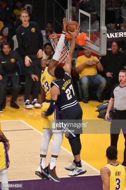 LeBron James of the Los Angeles Lakers blocks the ball against the Denver Nuggets on October 25 2018 at Staples Center in Los Angeles California NOTE...