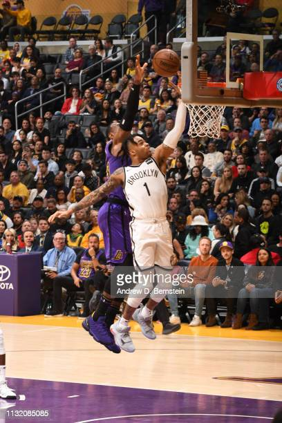 LeBron James of the Los Angeles Lakers blocks the shot of D'Angelo Russell of the Brooklyn Nets on March 22 2019 at STAPLES Center in Los Angeles...
