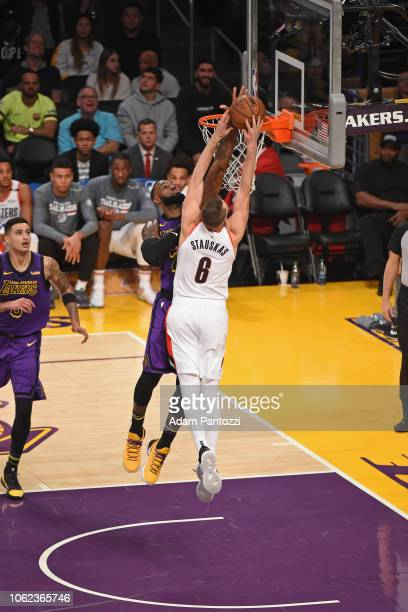 LeBron James of the Los Angeles Lakers blocks the shot of Nik Stauskas of the Portland Trail Blazers on November 14 2018 at Staples Center in Los...