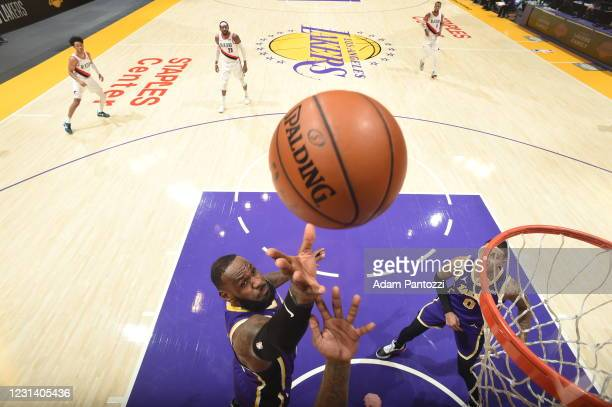 LeBron James of the Los Angeles Lakers catches the rebound during the game against the Portland Trail Blazers on February 26, 2021 at STAPLES Center...