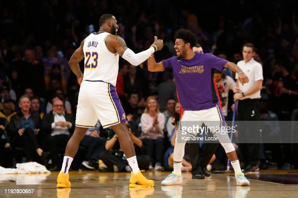 LeBron James of the Los Angeles Lakers celebrates a threepointer Quinn Cook of the Los Angeles Lakers during the fourth quarter against the Minnesota...